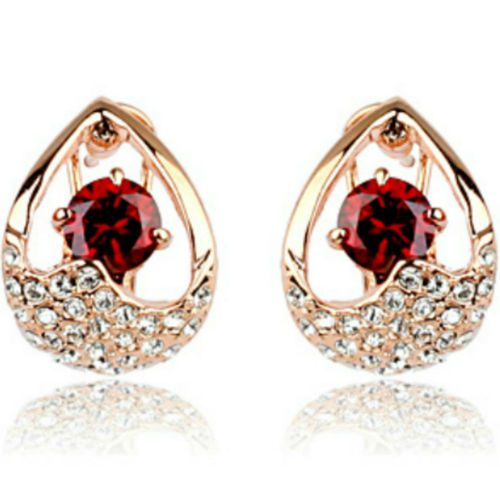 Red omega back earrings with rose gold finish