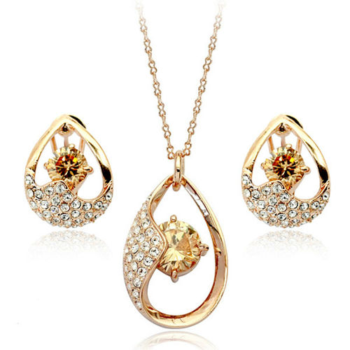 Jewellery set with gold colour cubic zirconias
